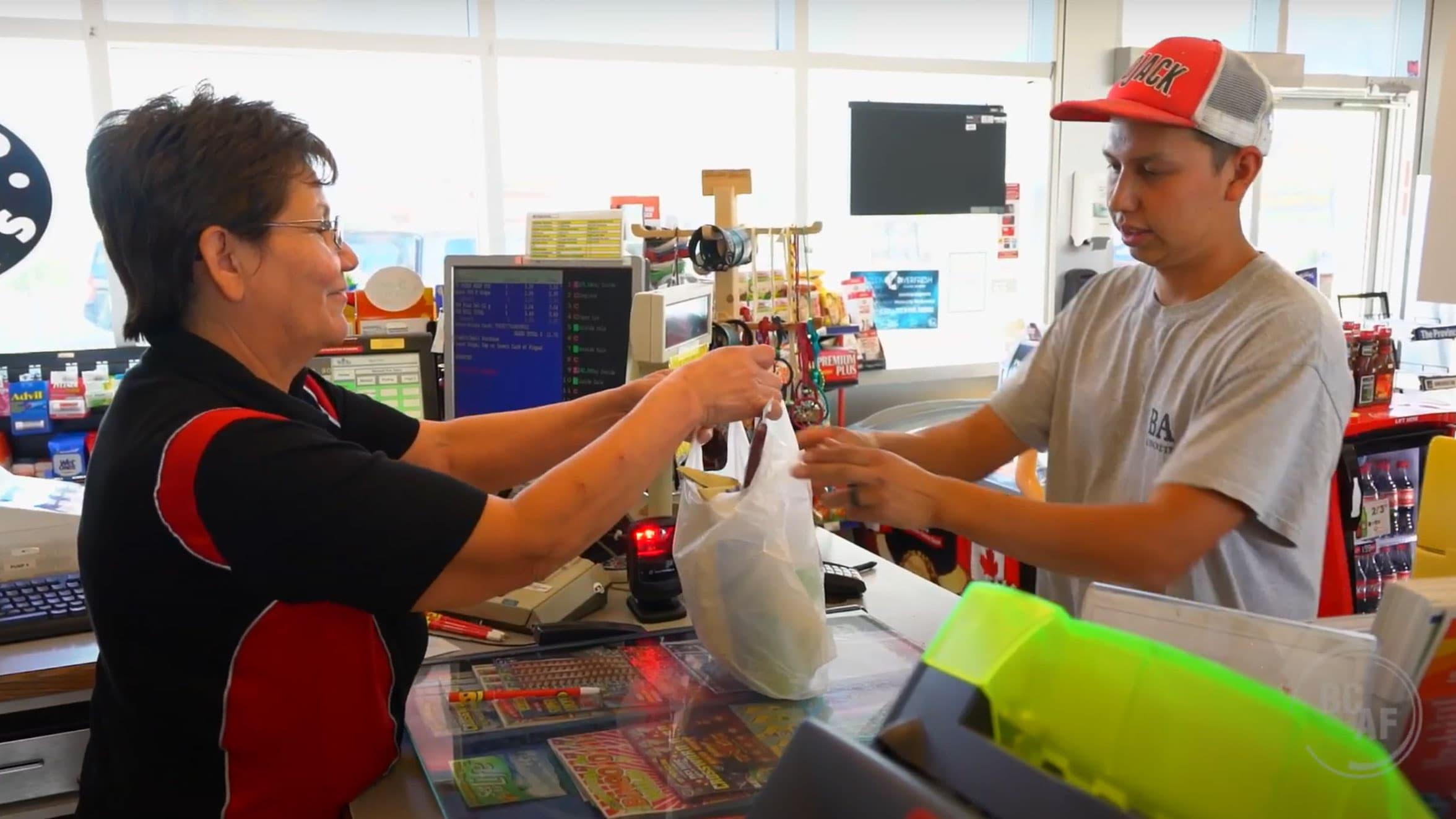 A Petro-Canada customer helps a guest.