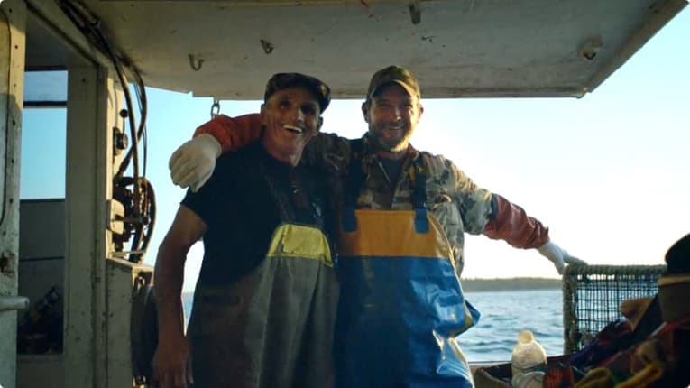 Screen capture from commercial – two men on a boat.