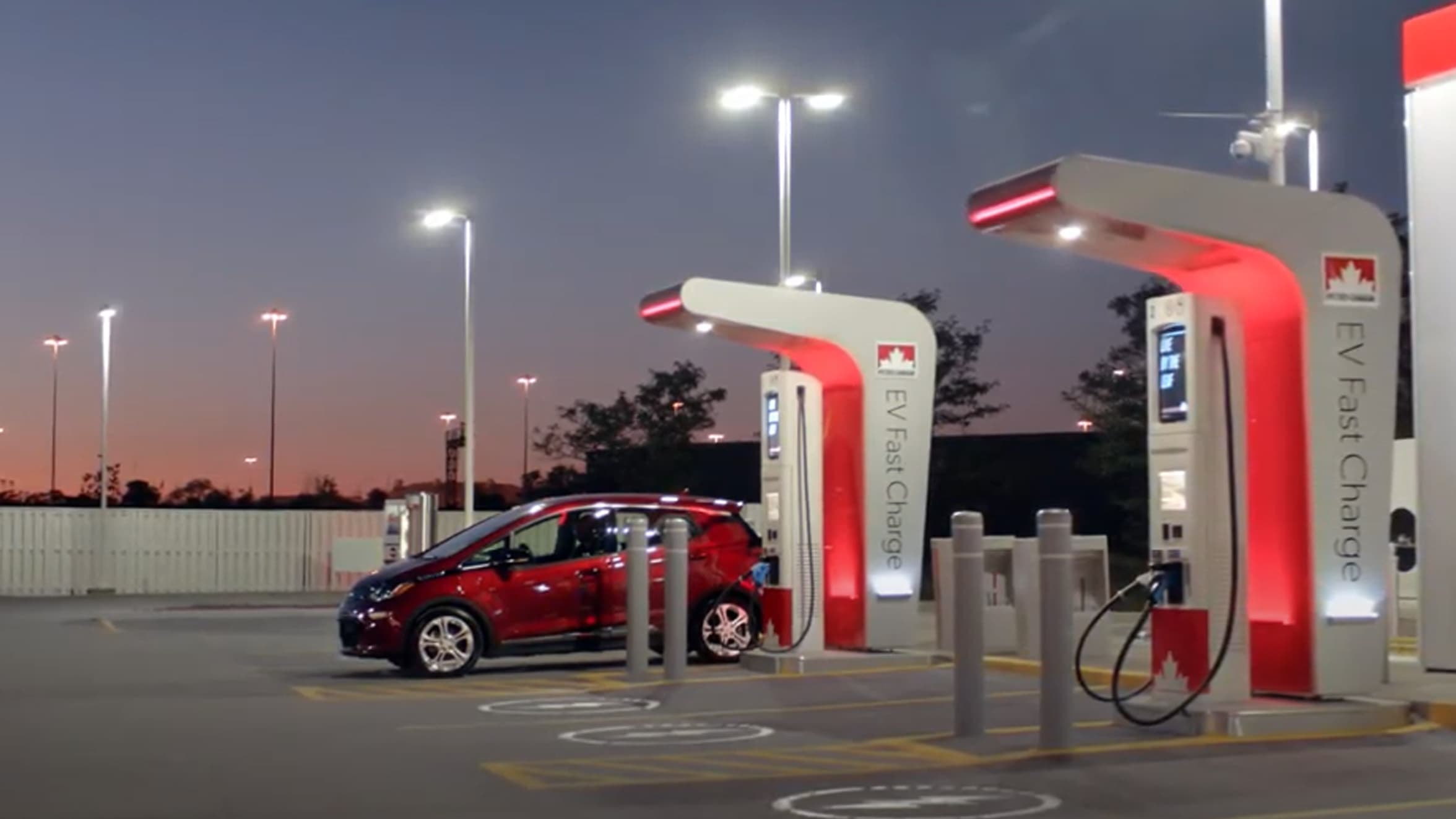 A car charges at a Petro-Canada EV fast charger.