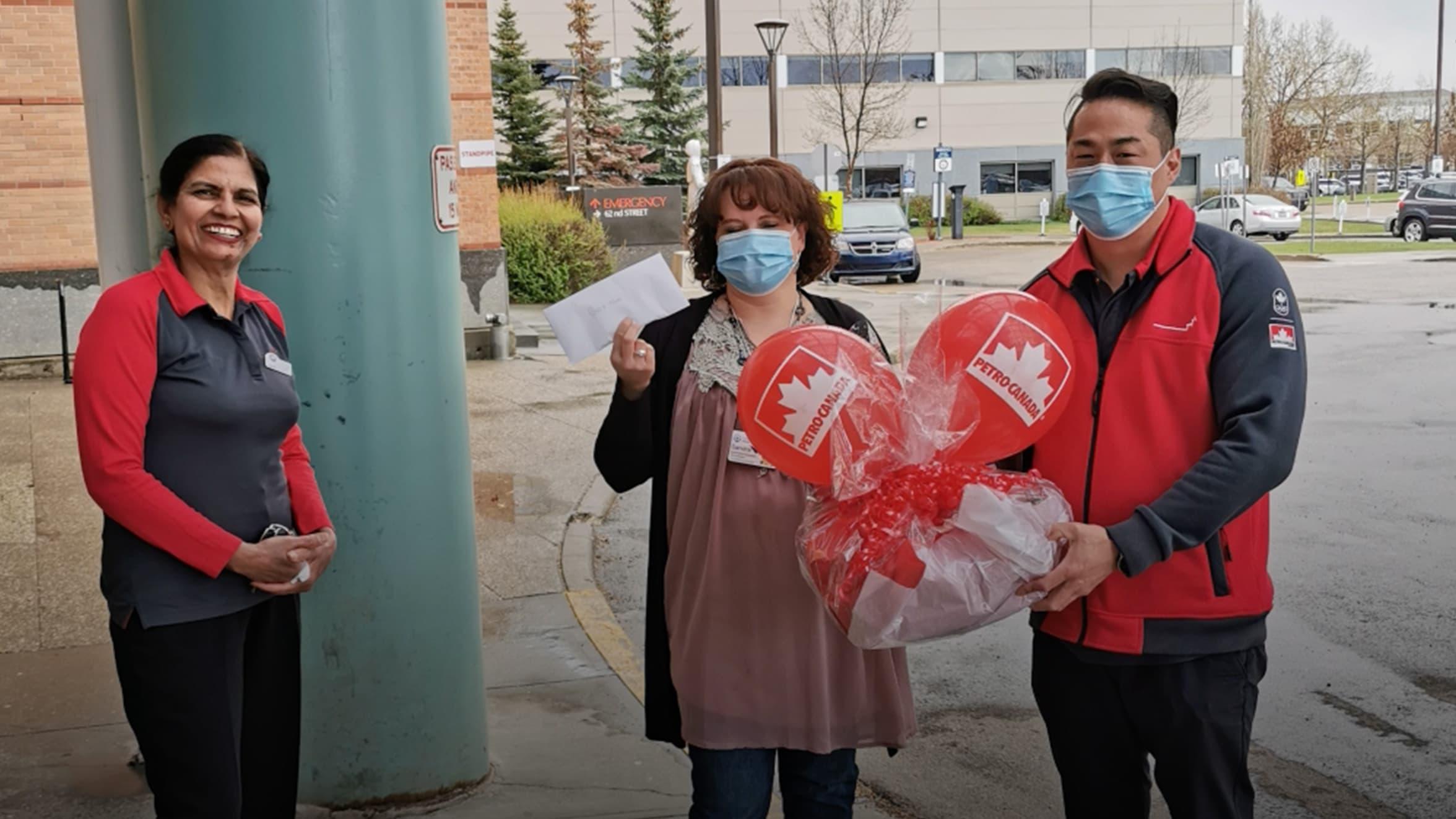 Petro-Canada team members donate to a hospital.