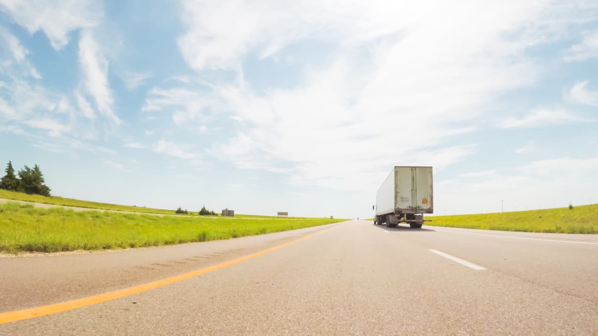 Transport truck driving on the road