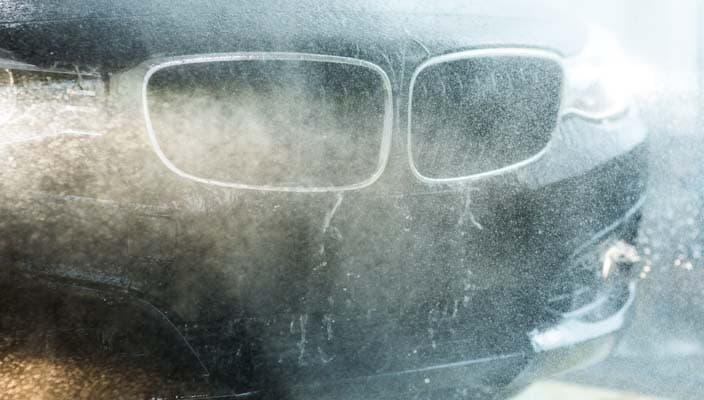 A BMW getting rinsed in a Petro-Canada car wash