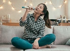 Girl singing karaoke.