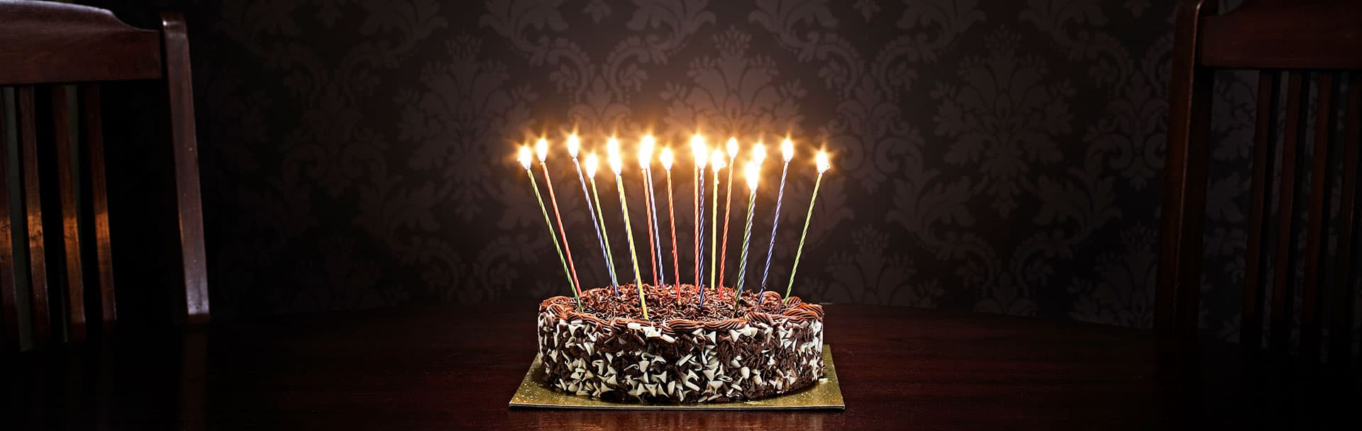 Birthday cake with lit candles.