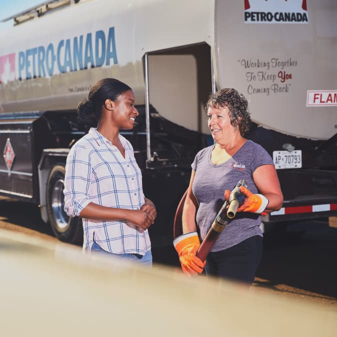 Two women discussing bulk fuel