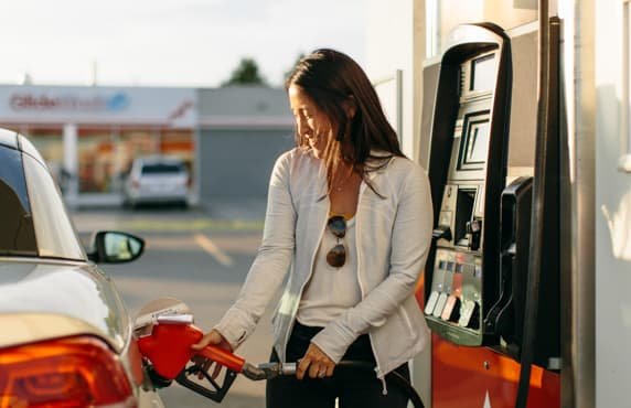 A woman filling her car at a Petro-Canada station.