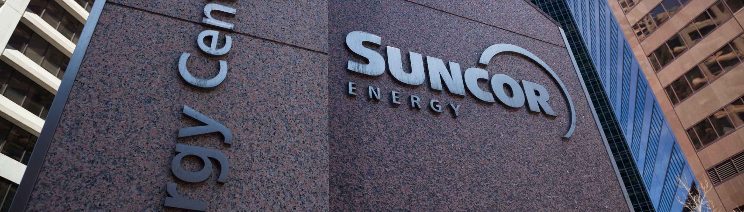 The granite sign in front of the Suncor Energy Centre.