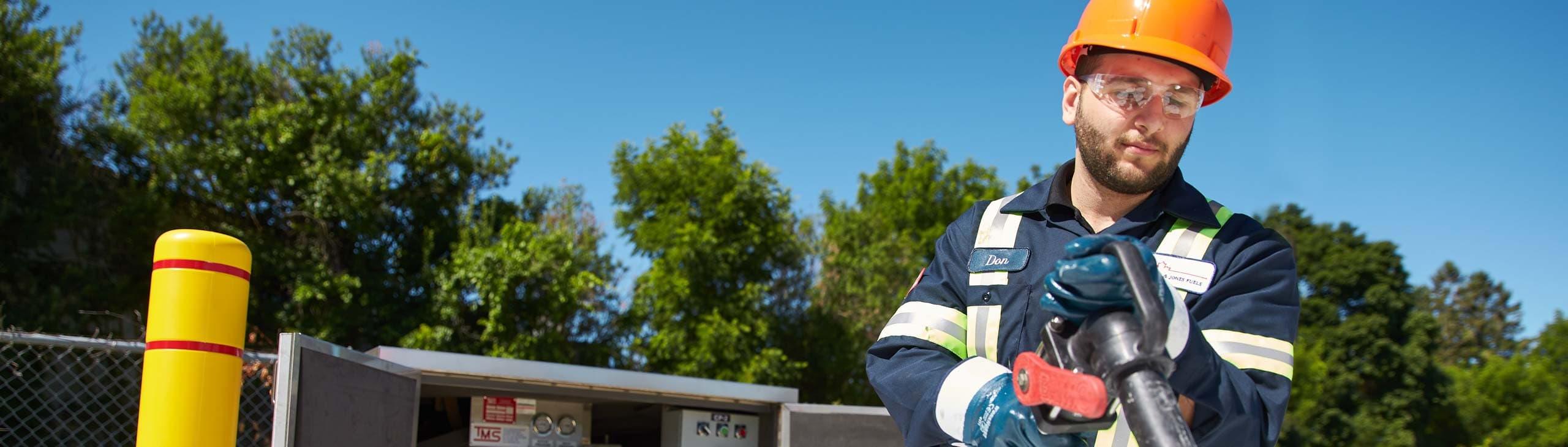 A technician delivering bulk fuel.