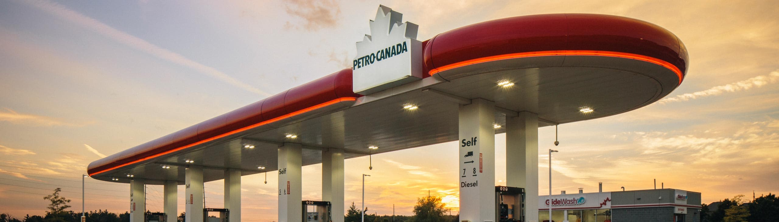 A Petro-Canada gas station at dusk.
