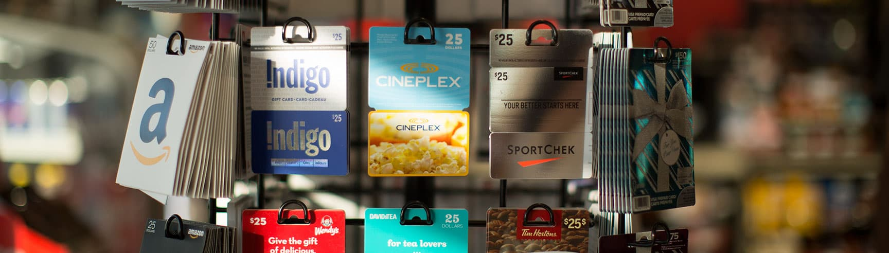 A rotary display of gift cards in a Petro-Canada store.